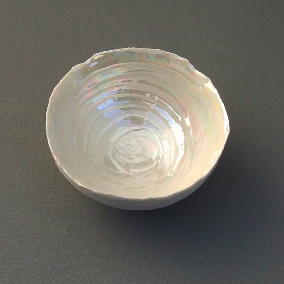 Image decorative hand made bowl in mother of white pearl finish.