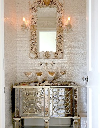 image bathroom tile mother of pearl with shell sink and mirrored dresser.
