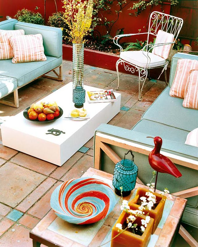 Design idea for outdoor living using blues and tangerine tango colors.