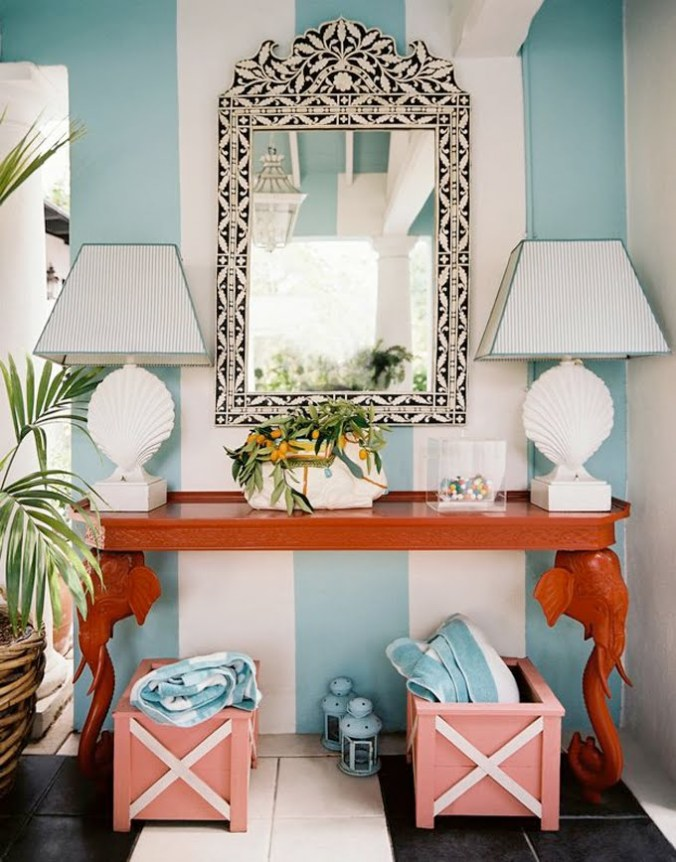Blue and white stripes wall treatment with pops of bold red-orange (tangerine tango) console table.