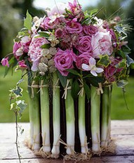 a vase of leeks and flowers!